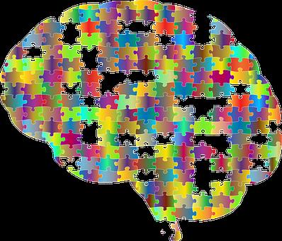un cerebro formado por piezas de puzzle de colores